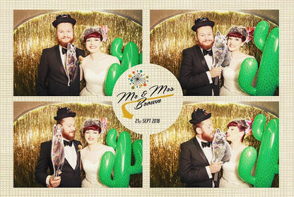 Silver trailer photobooth printed images of brides and grooms