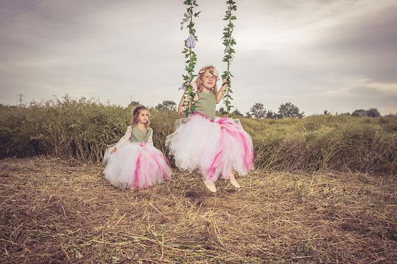 Tulle bridesmaid dresses on a swing