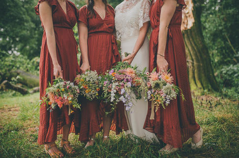 Flowers and red bridesmaid dresses
