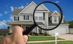 gray 2 story with front yard and magnifying glass.jpg