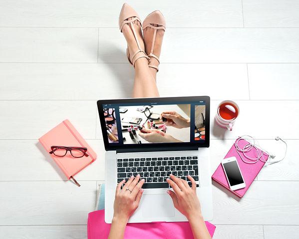 Woman watching online tutorial on laptop