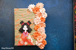 origami doll and paper flowers