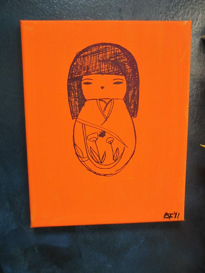 orange kokeshi