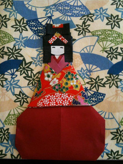 origami doll on canvas