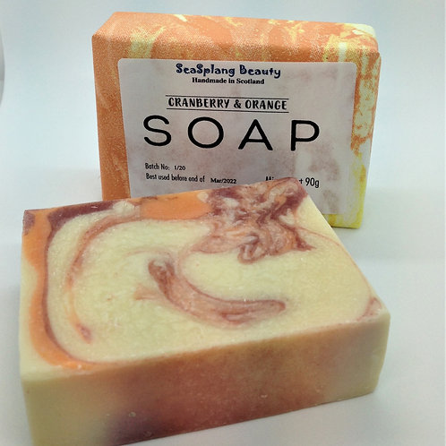 Seasplang Beauty Cranberry and Orange Soap, a white soap with red and orange swirls