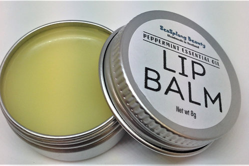 Opened labelled aluminium tin showng natural coloured balm