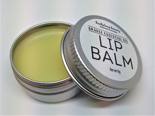 Opened labelled aluminium tin showing natural coloured lip balm