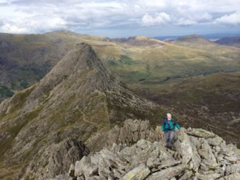 Pete reaching the end of Bristly Ridge, with Tryfan in the background