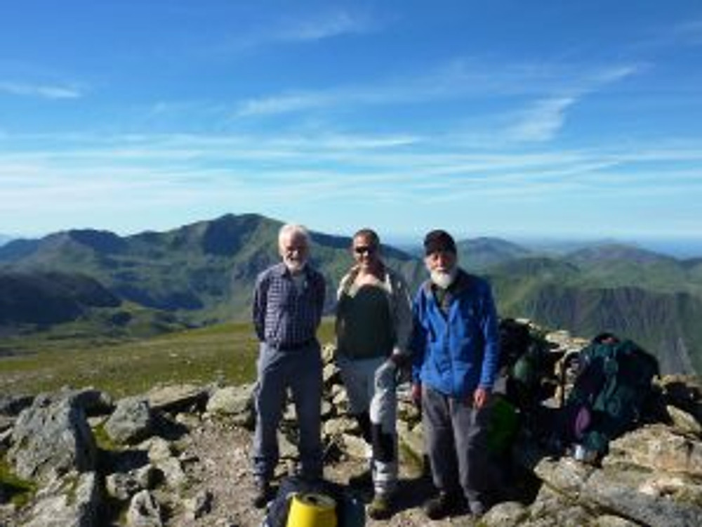 The three musketeers on the summit of Y-Garn with Snowdon in the background.