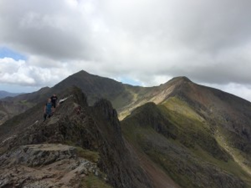 Dan and Connor at the start of the Crib Goch ridge, with Snowdon in the background