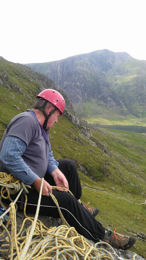 Dave belaying looking out over Ogwen valley