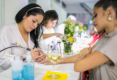 Nailbar Beauty Lounge technician performing nail services