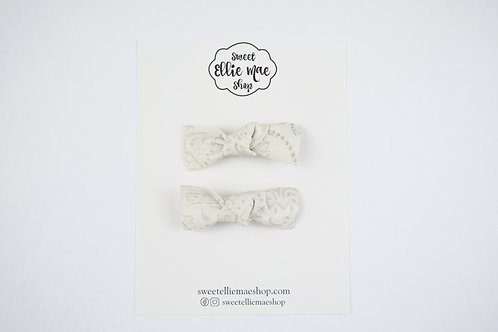 Antique White Embossed | Knotted Bow
