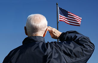 View of a veteran saluting the flag of t