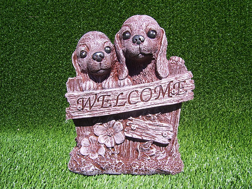 PUPPIES WITH WELCOME SIGN