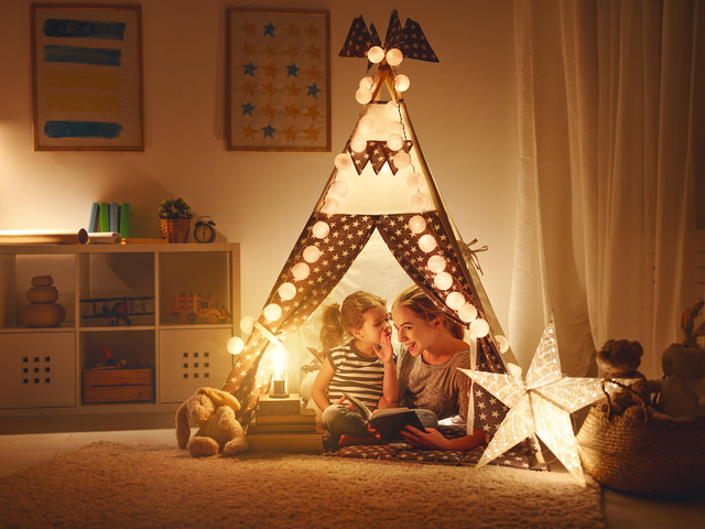 reading and family games in   tent. moth