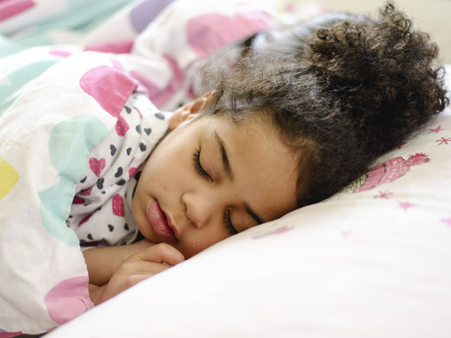 Little African American girl sleeping in