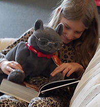 Girl reading to cat puppet.jpeg