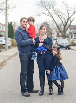 Family Standing in Street