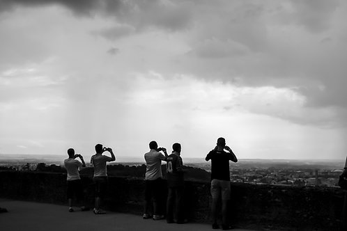 people taking photos, sky, cameras in hands
