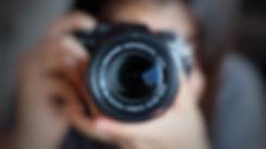 Soft focus of women photographer hold ca