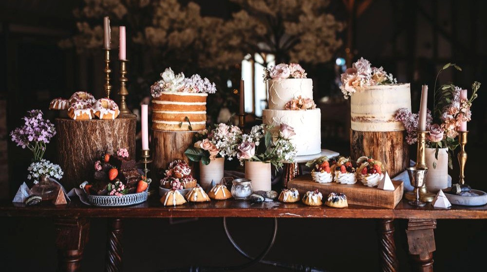 Wood table with cakes, cookies, cupcakes