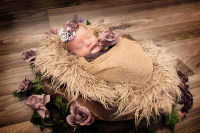 baby on driftwood photograph