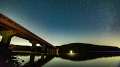 Milkway over bridge and lake   Time Lapse