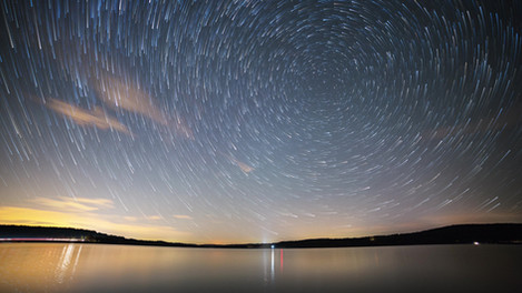 Star trails over lake | Time Lapse