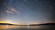 Star trails over lake   Time Lapse