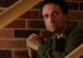 Charles MacKenzie sitting on staircase.j