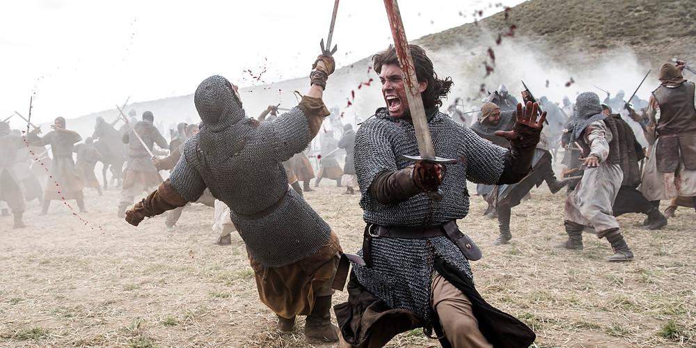 A foto mostra o personagem El Cid em uma batalha