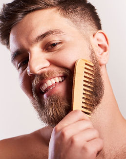 Attractive smiling Bearded man  holding