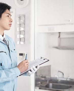Japanese male worker checking the equipm