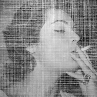 WOMAN SMOKING (CUBA)
