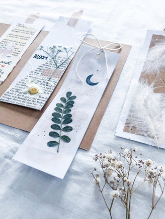 Bookmarks with dried flowers and old book pages