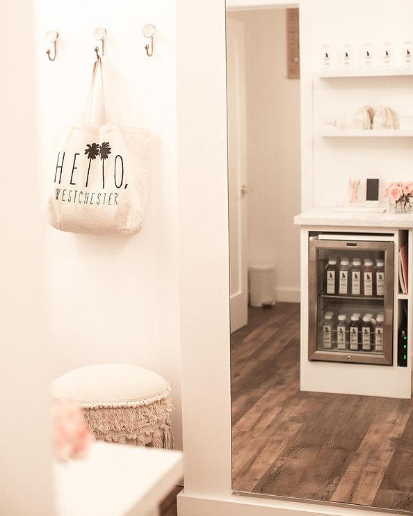 Studio Blu Inc, Westchester CA. interior designer, Westchester CA. Pilates Studio, White fresh interiors, Anthropoloy hooks, home goods stool, Mamai Wellness