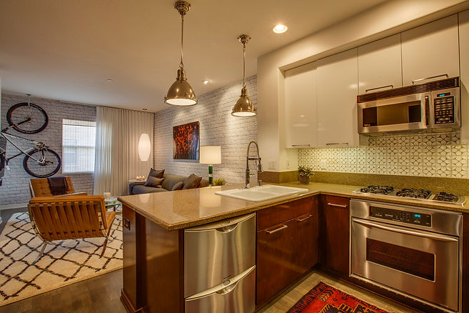 Studio Blu Inc, Playa Vista interior designer, Condo remodel, Ann Sacks tile, brick wall paper, ralph lauren pendants, warm contemporary kitchen, grey stain on floors,