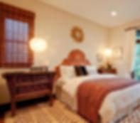 guest bedroom, moroccan rug, gold sun mirror, upholsterd headboard, Dos Gallos