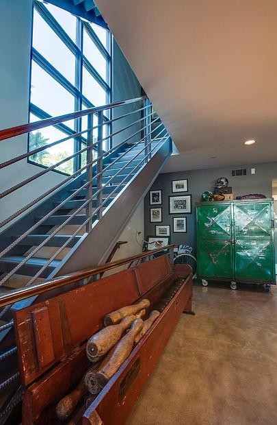studio blu inc, metal stairs, loft living, vintage bowling set, concrete floors