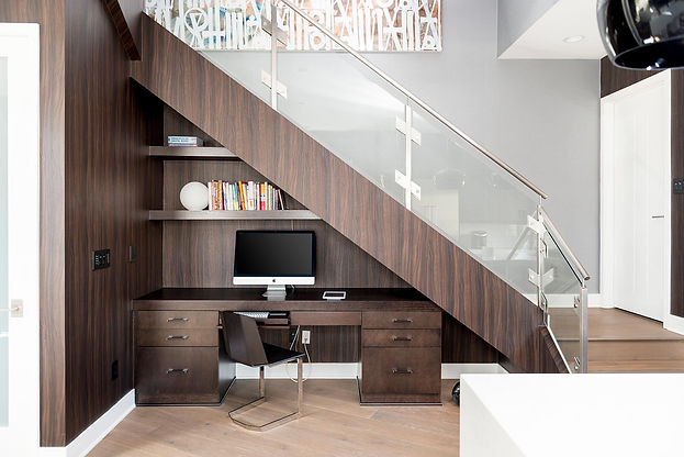 Studio blu inc, desk under stairs, brown wall paper, glass railings, modern home