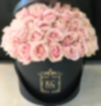 pink avalanche roses in a hat box