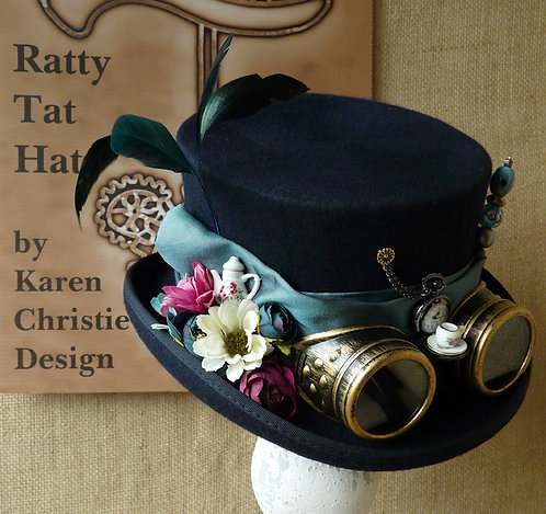 Lady's navy and turquoise Steampunk hat with an Alice in Wonderland vibe