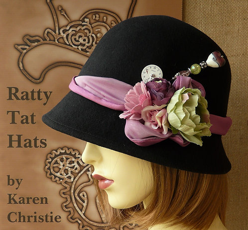 Lady's black symmetrical cloche hat with flowers, hatpin and antique watch parts, The Ellen Willmott by Ratty Tat Hats