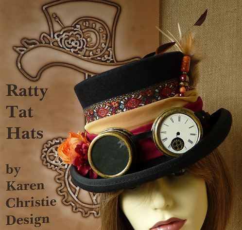 Tribal Steampunk top hat with goggles, hatpin, feathers and fabric bow. Pocahontas by Ratty Tat Hats.