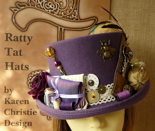 The Sewing Bee, a purple Steampunk top hat with a range of seamstress accoutrements