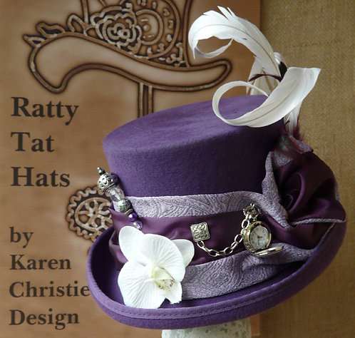 Lady's purple and lilac top hat with small pocket watch on chain, The Moth by Ratty Tat Hats