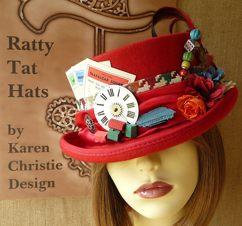 Lady's red Monopoly inspired Deadman or low crown top hat with vintage edition game parts. Trafalgar Square by Ratty Tat Hats