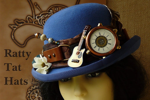 Lady's royal blue Steampunk style bowler or Derby hat with mon-goggle and guitar, Singin' the Blues by Ratty Tat Hats