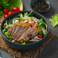 Grilled beef steak salad with vegetables and sauce. healthy food